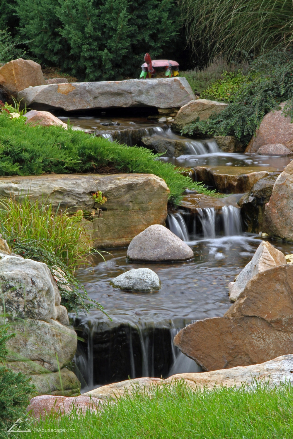 Pondless waterfall design construction tips for beginners for Waterfall supplies